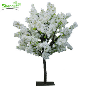 White artificial cherry blossom wedding tree