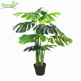 Indoor artificial plastic monstera plant